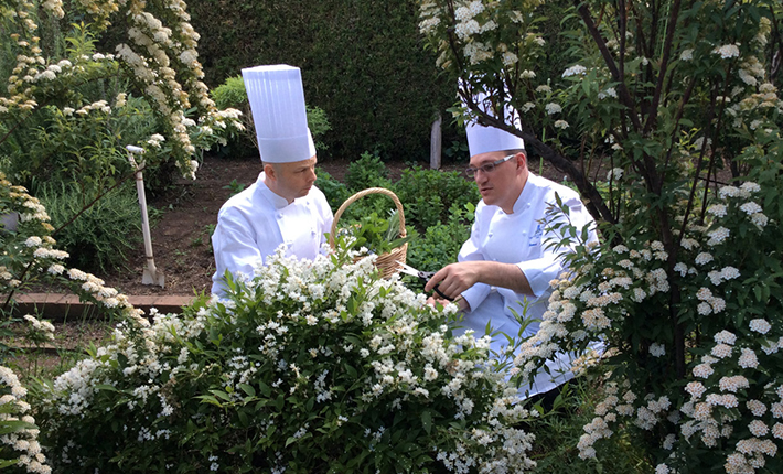 Executive Chef Renaud Augier and Head Pâtissier Loïc Pivot in Tour d'Argent Tokyo's herb garden, located on the rooftop of Hotel New Otani Tokyo